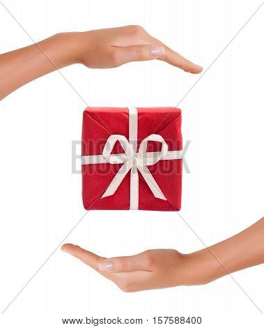 Red Gift Box between hands on white background