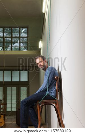 portrait of man grizzled , old industrial space background
