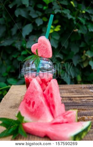 Watermelon Cocktail With Slice On Wooden Background. Heart Carved From   The Tube.