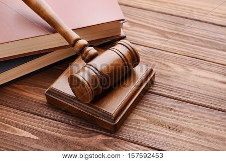 Gavel with sound block and books, closeup