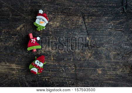 Christmas symbols snowman owl and winter hat on an old wooden background with place for text. Christmas decoration. Xmas time background. Winter holidays. Christmas concept. Top view. Copy space.