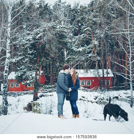 Young Loving Couple Embracing And Having Fun In Winter