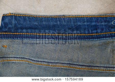 Blue jean seams on gray