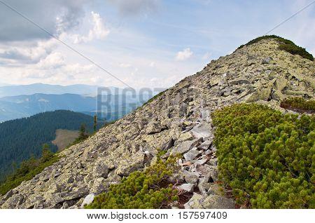 Path through the stone field to the mountain peak