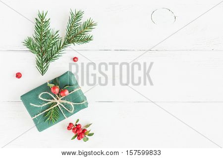 Christmas composition. Christmas gift fir branches. Flat lay top view