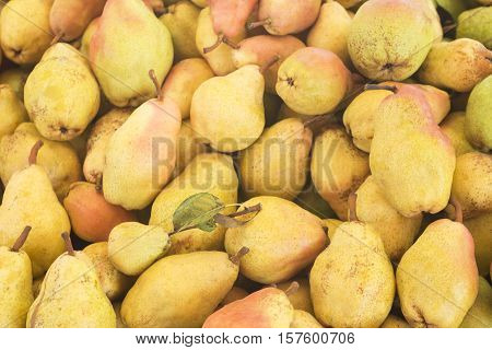 Pears. Pears harvest. Pears close up. Pears from supermarket. Market stall pears. Yellow pears.