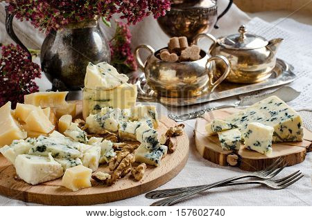 Assorted Cheeses On The Table.