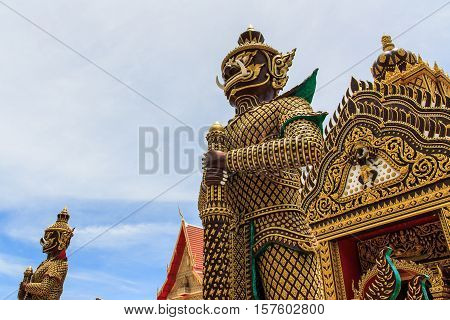 Giant statue in front temple doors Prachuap Khiri Khan Thailand