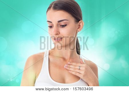 girl takes care her skin with cream isolated on white background. Health care concept. Body care concept. Young woman with healthy skin.