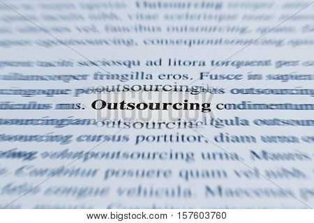 Text the word outsourcing highlighted the effect of blur in motion