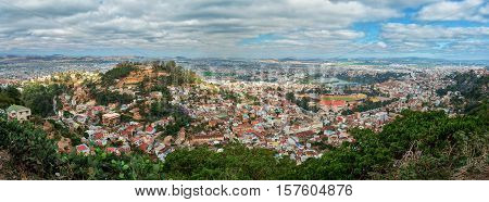 Panorama of Antananarivo french Tananarive short name Tana capital and largest city in Madagascar Madagasikara republic. Vie from top to Central Antananarivo including Lake Anosy.