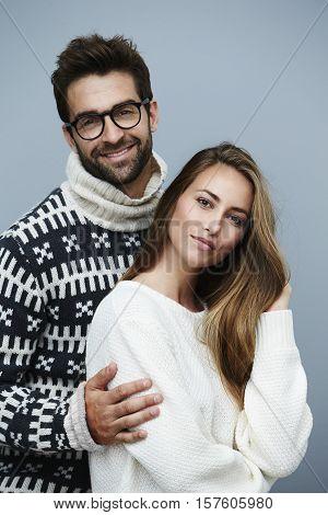 Portrait of couple in knitwear studio studio shot