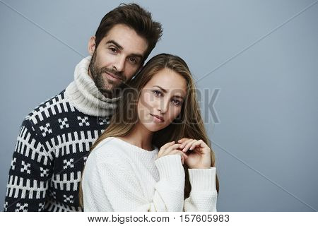 Knitwear couple in studio portrait studio shot