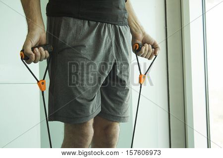 Man performing exercises with resistance rope fitness