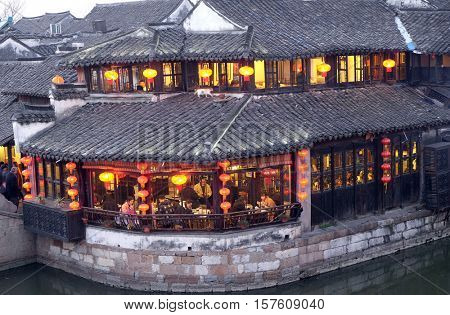 XITANG - FEBRUARY 20: Chinese water village Xitang. It is one of six destination ancient Town, located in Zhejiang Province, China, February 20, 2016.