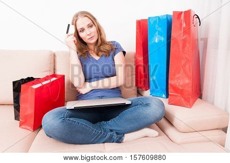 Woman Sitting On Couch Feeling Pensive Of Something