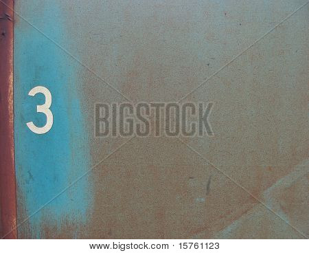 number 3 on a rusty blue metal surface poster