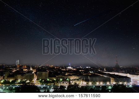 skyscraper turin with shooting star night light