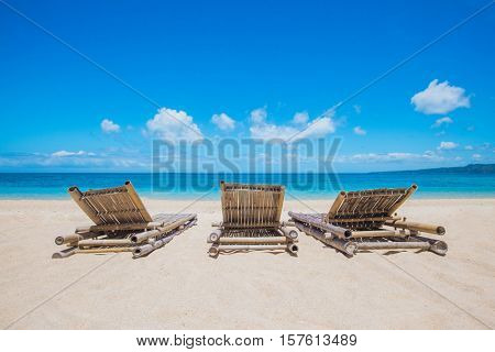 Beautiful tropical sea beach with chaise lounge