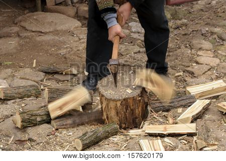 Man chopping fire wood with motion blur