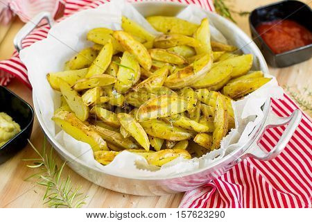 Roasted potato wedges with herbs and rosemary