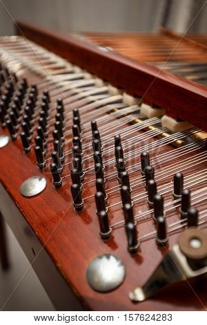 Wooden dulcimer traditional musical instrument, close up