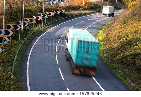 Lorries blurred in motion on the road