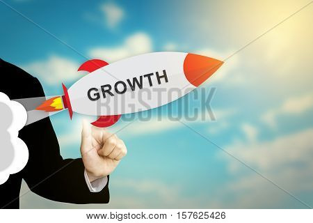 business hand clicking growth flat design rocket