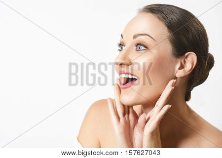 Beauty Fashion Surprised happy young woman looking sideways in excitement. Expressive facial expressions. Emotions. Isolated over white background