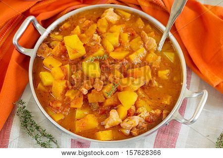 Pumpkin stew with pork meat and potatoes