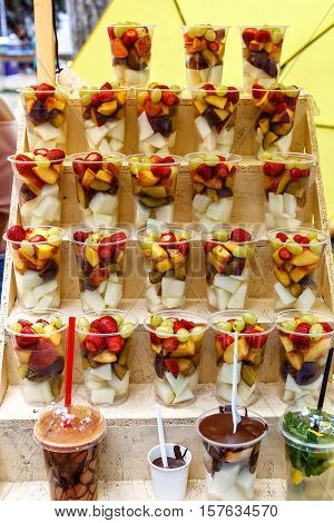 Plastic Cups Of Sliced Fruit. Strawberry, Blackberry, Kiwi, Pineapple, Raspberry, Plum, Grapes, Melo