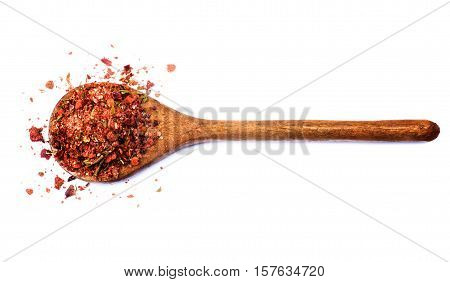 Homemade Dried and Crushed Chili Pepper with Herb and Spices in Wooden Spoon isolated on White background