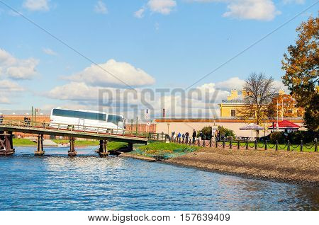 ST PETERSBURG RUSSIA-OCTOBER 3 2016. Kronverk bridge and touristic bus crossing the Kronverk strait in St Petersburg Russia. Architecture city landscape of St Petersburg in autumn sunny weather
