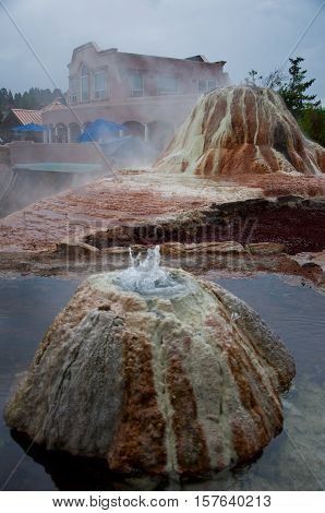 Hot Springs at Pagosa Springs , Colorado USA with Steam rising and sulfur smell in the air natural forming hot springs rise near the San Juan River