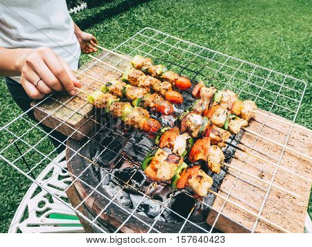 Cooking Barbeque In The Garden.