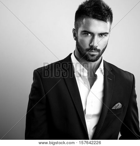 Elegant young handsome man. Black-white studio fashion portrait.