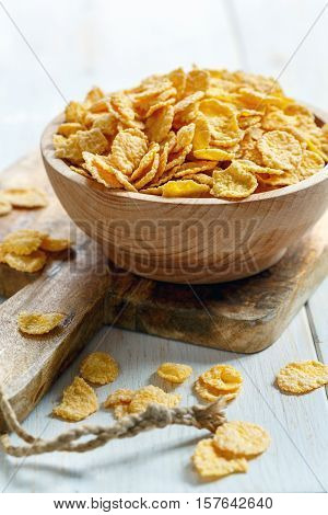 Crispy Corn Flakes In A Wooden Bowl.
