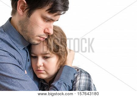 Young Man Is Hugging His Sad Girlfriend. Consoling And Compassio