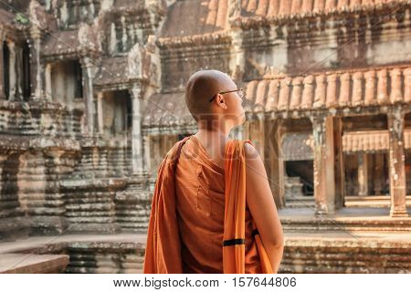 Closeup View Of Buddhist Monk Looking At Courtyard Of Angkor Wat