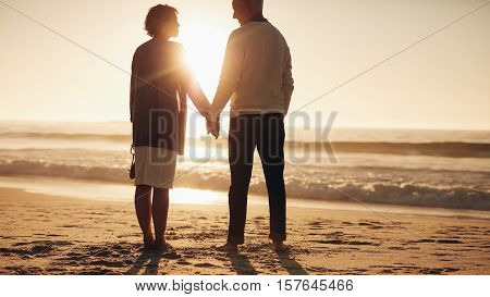 Senior Couple Spending Some Time On The Beach At Sunset