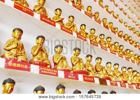 Small Golden Buddha Statues In The Interior Of The Ten Thousand Buddhas Monastery