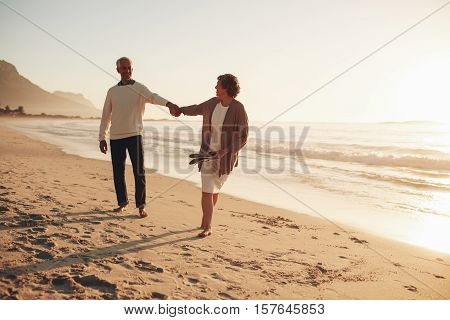 Playful Senior Couple On The Beach