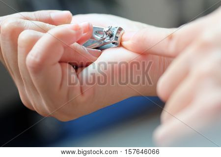 close up of Cutting nails using nail clipper