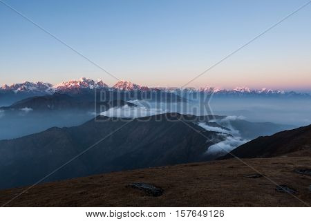 Snowy Peaks Panorama With Amazing Clouds Floating Between Mountains On The Sunrise. Himalayas Snowy