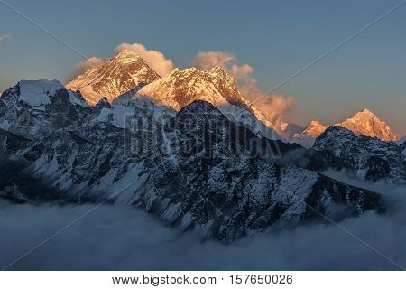 Mount Everest View From Gokyo Ri. Picturesque Mountain Peak Surrounded By Curly Clouds At Sunset. Dr