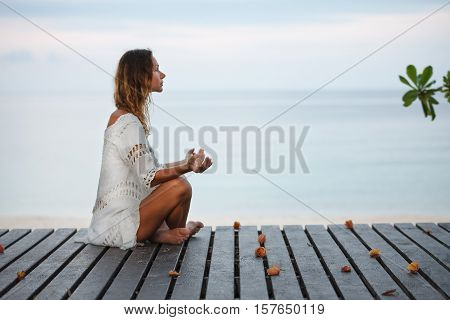 Portrait of young woman. fitness, yoga, perfect tanned body, healthy skin. Travel and Vacation. Freedom Concept. Outdoor shot