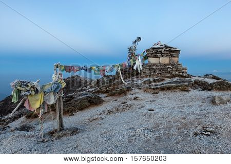 Buddhist Prayer Flags On A Buddhist Chorten On Everest Base Camp Route In Himalayas, Nepal. Waving B