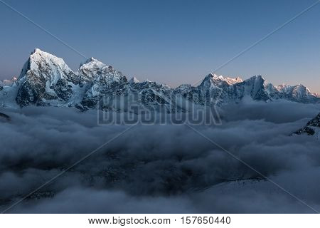 Mountain Cholatse View From Gokyo Ri. Beautiful Mountain Valley Covered With Grey Gloomy Clouds At S