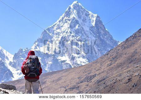 A Trekker walking at high Himalaya mountain.