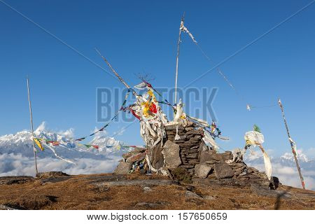 Buddhist Prayer Flags On A Buddhist Chorten In High Himalayan Mountains, Nepal. Waving Buddhist Pray
